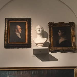 Bust of Alexander Hamilton, flanked by portraits of Aaron and Theodosia Burr, in the New York Historical Society